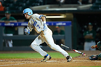 Logan Warmoth (7) of the North Carolina Tar Heels follows through on his swing against the Miami Hurricanes in the second semifinal of the 2017 ACC Baseball Championship at Louisville Slugger Field on May 27, 2017 in Louisville, Kentucky. The Tar Heels defeated the Hurricanes 12-4. (Brian Westerholt/Four Seam Images)