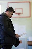 Moscow, Russia, 04/03/2012..A voter studies the ballot paper as Russians vote in the Presidential election, which Prime Minister Vladimir Putin is expected to win in the first round.
