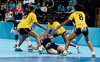23 NOV 2011 - LONDON, GBR - Britain's Nina Heglund (#5, in blue) finds her path to goal blocked by Angola's Rossana Quitongo (#20, in yellow and black), Joelma Viegas  (centre, in yellow and black) and Nair Almeida (right, in yellow and black) during the 2011 London Handball Cup match at The Handball Arena in the Olympic Park in Stratford, London  (PHOTO (C) NIGEL FARROW)