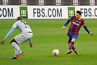 19th December 2020; Camp Nou, Barcelona, Catalonia, Spain; La Liga Football, Barcelona versus Valencia;  Leo Messi plays the ball through the defensive line of Valencia