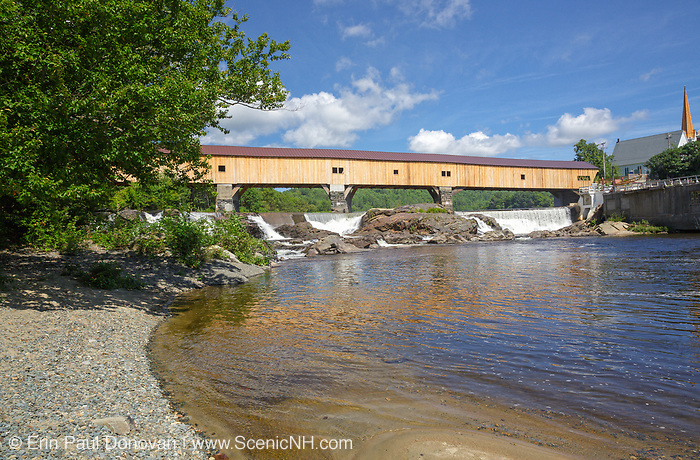 The Bath Covered Bridge in Bath, New Hampshire during the summer months. This historic covered bridge crosses over the Ammonoosuc River.