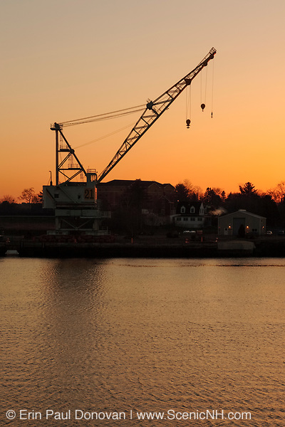The silhouette of a crane at Portsmouth Harbor in Portsmouth, New Hampshire USA during an April sunrise.