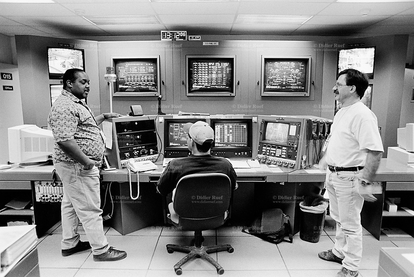 Usa. Utah. Tooele county. Deseret chemical depot. Three workers at the control room.Thw white men and a black man, an afroamerican. Tooele chemical agent disposal facility (TOCDF). Program for destruction of chemical weapons and agent. Deseret chemical depot is distant 100 km from Salt Lake City. The Deseret Chemical Depot is one of eight Army installations in the U.S. that currently store chemical weapons. The weapons originally stored at the depot consisted of various munitions and ton containers, containing GB and VX nerve agents or H, HD, and HT blister agent. The Tooele Chemical Agent Disposal Facility is designed for the sole purpose of destroying the chemical weapons stockpile located at the depot. © 1998 Didier Ruef