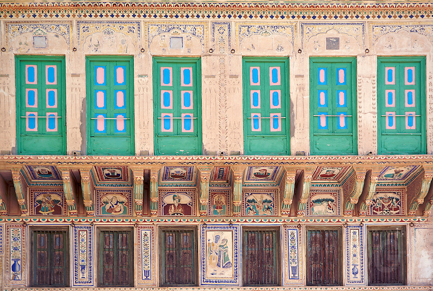 Founded in the 18th century, the medieval fort of Mandawa dominates the town with a painted arched gateway adorned with Lord Krishna and his cows. The Chokhani and Ladia havelis and the street with Saraf havelis are some of the splendid examples of this region's havelis..The Binsidhar Newatia Haveli has some curious paintings on its outer eastern wall-a boy using a telephone, and a European woman in a car driven by a chauffeur. The Gulab Rai Ladia Haveli has some defaced erotic images..Rajasthan India,