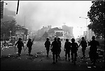 Summer '98-- Jakarta, Indonesia -- Angry citizens burn the Golkar flag in the streets, during the campaigning period.  President Suharto was a member of Golkar..