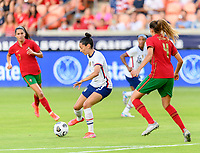 HOUSTON, TX - JUNE 10: Christen Press #23 of the United States passes the ball to a teammate during a game between Portugal and USWNT at BBVA Stadium on June 10, 2021 in Houston, Texas.