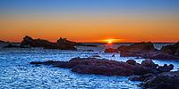 Colorful first sunrise sunrays on Pointe Nard Viou rocks near Saint Clair beach, Le Lavandou resort town, French Riviera (Côte d'Azur) France