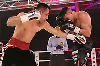 19th December 2020, Hamburg, Germany; Universal Boxing Promotion fight, Felix Sturm versus Timo Rost; Left body jab from Rost