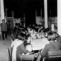 Comrade Duch (left, facing camera) with staff eating lunch at the S-21 Khmer Rouge detention centre at Tuol Sleng. Duch (real name Kaing Guek Eav) was chief executioner of the Khmer and responsible for Tuol Sleng, where over 16,000 people were killed between 1975 and 1979. Photographer Nic Dunlop unearthed Duch working with the American Refugee Committee in 1999. He is currently awaiting trial. The photograph was taken by the Khmer.