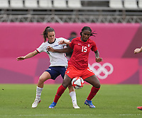KASHIMA, JAPAN - AUGUST 2: Kelley O'Hara #5 of the United States battles for the ball with Nichelle Prince #15 of Canada during a game between Canada and USWNT at Kashima Soccer Stadium on August 2, 2021 in Kashima, Japan.