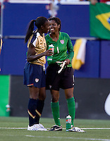 Tina Ellertson celebrates with Briana Scurry. USA defeated Brazil 2-0 at Giants Stadium on Sunday, June 23, 2007.