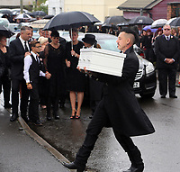 """COPY BY TOM BEDFORD<br /> Pictured: Paul Black carries the white coffin of his daughter Pearl to the Jerusalem Baptist Chapel in Merthyr Tydfil, Wales, UK. Friday 18 August 2017<br /> Re: The funeral of a toddler who died after a parked Range Rover's brakes failed and it hit a garden wall which fell on top of her will be held today at Jerusalem Baptist Chapel in Merthyr Tydfil.<br /> One year old Pearl Melody Black and her eight-month-old brother were taken to hospital after the incident in south Wales.<br /> Pearl's family, father Paul who is The Voice contestant and mum Gemma have said she was """"as bright as the stars""""."""