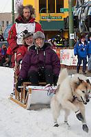 Musher Sebastian Schnuelle and Iditarider Tamara Balster-Hess leave the 2011 Iditarod ceremonial start line in downtown Anchorage, Alaska
