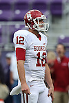 Oklahoma Sooners quarterback Landry Jones (12) in action during the game between the Oklahoma Sooners and the TCU Horned Frogs  at the Amon G. Carter Stadium in Fort Worth, Texas. OU defeats TCU 24 to 17....
