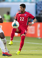 CHARLOTTE, NC - JUNE 23: Roberney Caballero #22 attempts to control the ball during a game between Cuba and Canada at Bank of America Stadium on June 23, 2019 in Charlotte, North Carolina.