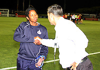 Briana Scurry #1 of the Washington Freedom with team president Mark Washco at her retirement ceremony during a WPS match against the Atlanta Beat at Maryland Soccerplex on September 11 2010, in Boyds, Maryland. Freedom won 1-0.