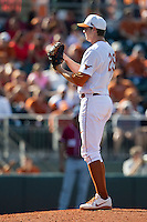 Texas Longhorns pitcher Corey Knebel #29 looks to his catcher for the sign against the Oklahoma Sooners in the NCAA baseball game on April 6, 2013 at UFCU DischFalk Field in Austin, Texas. The Longhorns defeated the rival Sooners 1-0. (Andrew Woolley/Four Seam Images).