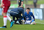 St Johnstone v Rangers…22.09.19   McDiarmid Park   SPFL<br />Scott Tanser receives treatment from physio Mel Stewart<br />Picture by Graeme Hart.<br />Copyright Perthshire Picture Agency<br />Tel: 01738 623350  Mobile: 07990 594431
