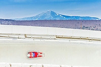 5 December 2014: David Mair, sliding for Italy, slides through Curve Number 14 on his first run, ending the day with a 15rd place finish and a combined 2-run time of 1:43.857 in the Men's Competition at the Viessmann Luge World Cup, at the Olympic Sports Track in Lake Placid, New York, USA. Mandatory Credit: Ed Wolfstein Photo *** RAW (NEF) Image File Available ***