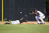 Nicholas Vizcaino (36) of the Danville Braves waits for a pick-off throw as Chase Lambert (2) of the Bristol Pirates dives back towards first base at American Legion Post 325 Field on July 1, 2018 in Danville, Virginia. The Braves defeated the Pirates 3-2 in 10 innings. (Brian Westerholt/Four Seam Images)