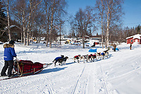 Rachel Scordis arrives at Grayling with Tim Osmar in the background during Iditarod 2009