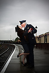 "© Joel Goodman - 07973 332324 . 24/05/2014 . Heywood Station , Railway Street , Heywood, UK . L-R Jane Francis (aka "" Lancashire Belle "") and former Flight Lieutenant Donald Ryan , who flew light aircraft in the RAF in the 1950s , kiss farewell on the platform . 1940s weekend on the East Lancs Railway , with visitors dressed up and partaking in 40s-themed events . Photo credit : Joel Goodman"