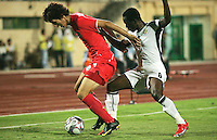 South Korea's Dong Sub Kim (9) keeps Ghana's Emanuel Agyemang-Badu (8) out of reach of the ball during the FIFA Under 20 World Cup Quarter-final match between Ghana and South Korea at the Mubarak Stadium  in Suez, Egypt, on October 09, 2009.