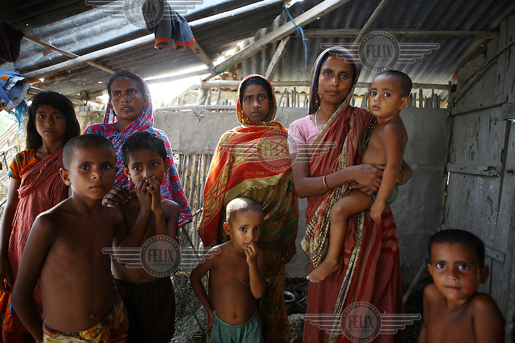 A family of displaced women and children in their village. Thousands of people were displaced in Shyamnagar Upazila, Satkhira district after Cyclone Aila struck Bangladesh on 25/05/2009, triggering tidal surges and floods...