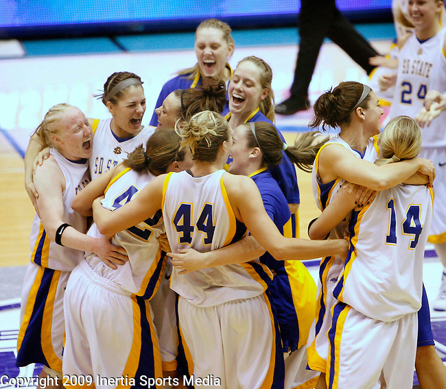 SIOUX FALLS, SD - MARCH 10:   South Dakota State players celebrate after winning the Summit League Women's Basketball Championship game against Oakland University Tuesday afternoon at the Sioux Falls Arena. (Photo by Dick Carlson/Inertia)