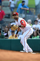 Arkansas Travelers third baseman Brian Hernandez (12) waits for a throw during a game against the San Antonio Missions on May 24, 2014 at Dickey-Stephens Park in Little Rock, Arkansas.  Arkansas defeated San Antonio 4-2.  (Mike Janes/Four Seam Images)