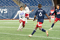 FOXBOROUGH, MA - OCTOBER 16: Gibran Rayo #14 of North Texas SC controls the ball during a game between North Texas SC and New England Revolution II at Gillette Stadium on October 16, 2020 in Foxborough, Massachusetts.
