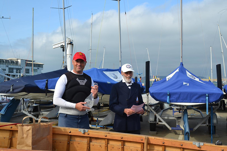 Mark Delany awarded his trophy by Vincent Delany from the Royal St George YC