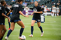 TACOMA, WA - JULY 31: Jimena Lopez #30 of the OL Reign warms up before a game between Racing Louisville FC and OL Reign at Cheney Stadium on July 31, 2021 in Tacoma, Washington.