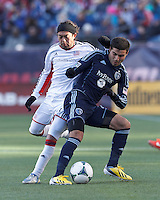 Sporting Kansas City midfielder Soony Saad (22) shields ball from New England Revolution midfielder Lee Nguyen (24).  In a Major League Soccer (MLS) match, Sporting Kansas City (blue) tied the New England Revolution (white), 0-0, at Gillette Stadium on March 23, 2013.