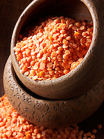 un-cooked rganic orange lentils - stock photos