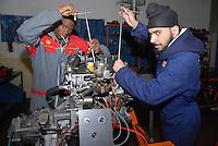 Parma / Italia<br /> Giovani richiedenti asilo assistiti dall'onlus CIAC beneficiano di programma di avviamento al lavoro che prevede lo studio all'istituto tecnico e la pratica in officina meccanica.<br /> Foto Livio Senigalliesi