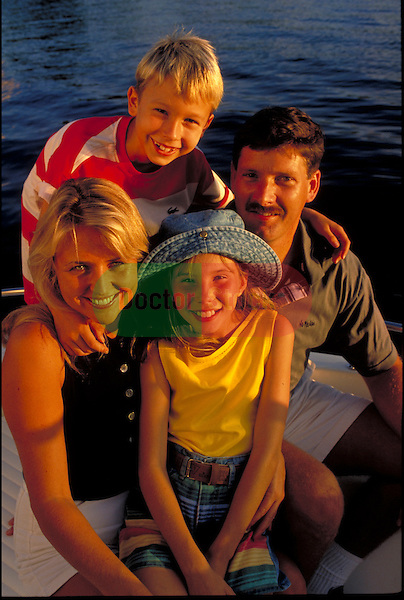 portrait of smiling family at beach