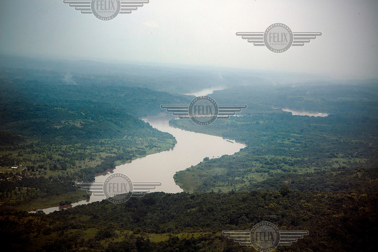 The Sankuru River, along part of which ophthalmologist<br /> Dr Richard Hardi travelled by canoe during an expedition to the remote village of Pania where he ran a cataract clinic. <br /> From his base in Mbuji Mayi Hungarian Ophthalmologist Friar Richard Hardi and his team travelled deep into the Congolese rainforest, by 4x4 and canoe, to treat people in isolated communities most of whom have never seen an Ophthalmologist. At a small village called Pania they established a temporary field hospital and over the next three days made hundreds of consultations. Although both conditions are preventable, many of the patients they saw had Glaucoma or River Blindness (onchocerciasis) that had permanently damaged their eyesight. However, patients with cataracts, a clouding of the eye's lens, who were suitable for treatment were booked for an operation. For two days the team carried out the ten minute procedure on one patient after another. The surgery involves making a 2.2mm incision into the remove the damaged lens that is then replaced by an artificial one. Doctor Hardi is one of the few people willing to make such a journey but is inspired to do so by his faith and, as he says: 'Here I feel that I can really make a difference in people's lives'. /Felix Features