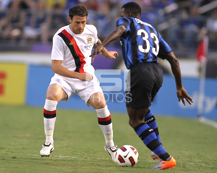 Nsofor Victor Obinna #33 of Inter Milan tries to get past Wayne Bridge #3 of Manchester City during an international friendly match on July 31 2010 at M&T Bank Stadium in Baltimore, Maryland. Milan won 3-0.
