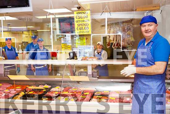 Listowel butcher John Griffin, right, pictured in his store with his assistants John O'Hare, Mike Riordan, Des Daly & Nora Anne Lyons.