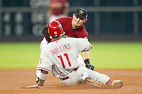 Houston Astros shortstop Tyler Greene #27 attempts to tag Phillies baserunner Jimmy Rollins #11 during the Major League baseball game against the Philadelphia Phillies on September 16th, 2012 at Minute Maid Park in Houston, Texas. The Astros defeated the Phillies 7-6. (Andrew Woolley/Four Seam Images).