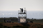 TV camera man taking in the sea views <br /> during day one of The Senior Open Golf Tournament at The Royal Porthcawl Golf Club in South Wales this afternoon.