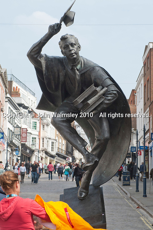"""""""The Surrey Scholar"""".  Sculpture by Allan Sly FRBS (www.allansly.co.uk) in the High Street, Guildford, Surrey.  Presented to the borough to celebrate Guildford as a place of culture and scholarship by Professor Patrick Dowling, Vice Chancellor, on behalf of the University of Surrey, May 2002."""