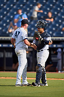 Tampa Tarpons pitcher Matt Sauer (47) and catcher Carlos Narvaez (5) after closing out a game against the Jupiter Hammerheads on July 2, 2021 at George M. Steinbrenner Field in Tampa, Florida.  (Mike Janes/Four Seam Images)