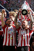 Pontus Jansson holds the Championship Trophy aloft as Brentford celebrate promotion to the Premier League during Brentford vs Swansea City, Sky Bet EFL Championship Play-Off Final Football at Wembley Stadium on 29th May 2021