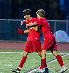 CHESHIRE, CT-111220JS16—Cheshire's Clement Pez (50) is congratulated by teammate Murphy Malone (11) after scoring a goal during their SCC Division A semifinal game against North Haven Thursday at Cheshire High School.<br /> Jim Shannon Republican-American