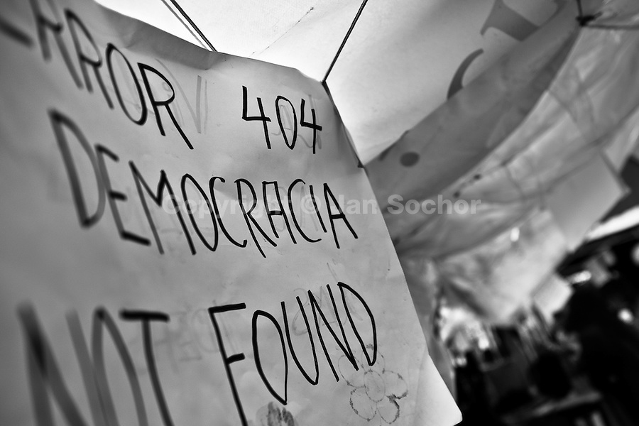 A political banner (Error 404, Democracy not found) hanging inside the protest camp on Puerta del Sol square, Madrid, Spain, 7 June 2011.