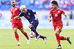 Chanathip Songkrasin of Thailand (L) in action against Sayed Redha Isa of Bahrain during the AFC Asian Cup UAE 2019 Group A match between Bahrain (BHR) and Thailand (THA) at Al Maktoum Stadium on 10 January 2019 in Dubai, United Arab Emirates. Photo by Marcio Rodrigo Machado / Power Sport Images