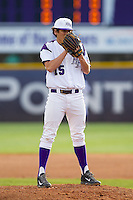 High Point Panthers starting pitcher John McGillicuddy (15) looks to his catcher for the sign against the Coastal Carolina Chanticleers at Willard Stadium on March 14, 2014 in High Point, North Carolina.  The Panthers defeated the Chanticleers 3-0.  (Brian Westerholt/Four Seam Images)