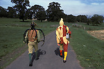 Abbots Bromley Horn dance. Staffordshire. The Fool and one of the dancers. UK. September 1979.